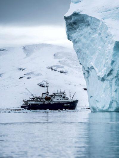 Boat near Iceberg -  Hubert Neufeld